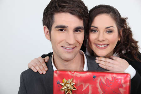 Man receiving a present from his girlfriend Stock Photo - 16669541
