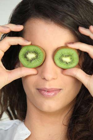 Woman with kiwi eyes photo