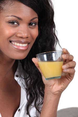 gorgeous black woman drinking orange juice photo