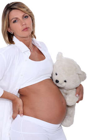 Pregnant woman with teddy bear photo