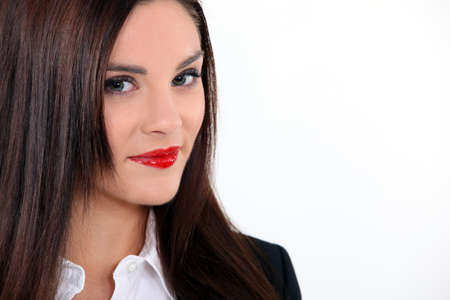Attractive brunette businesswoman wearing red lip-stick Stock Photo - 16669776