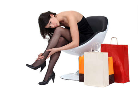 miniskirt: Women sat surrounded by shopping bags
