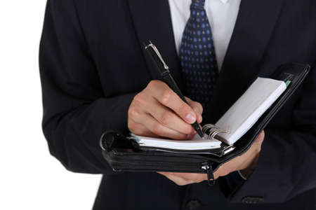 Man writing in his business diary Stock Photo - 16670446