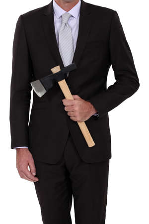 psycho: Businessman with an axe Stock Photo