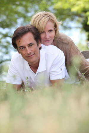 Married couple laying in a field Stock Photo - 16670079