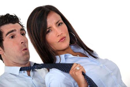possessive: Woman pulling man