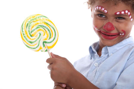 disguised: Child made-up holding a lollipop
