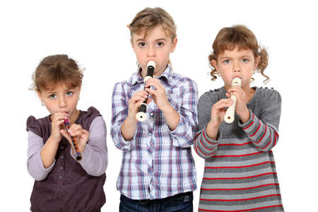 three little girls playing flute photo