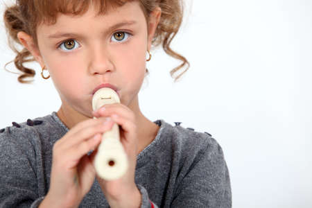 wind instrument: little girl playing flute