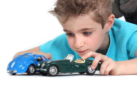 little boy playing with cars photo