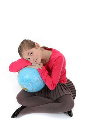 Girl hugging a globe photo