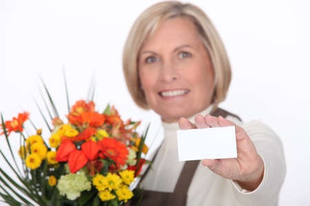 Florist with a blank card Stock Photo - 16670679