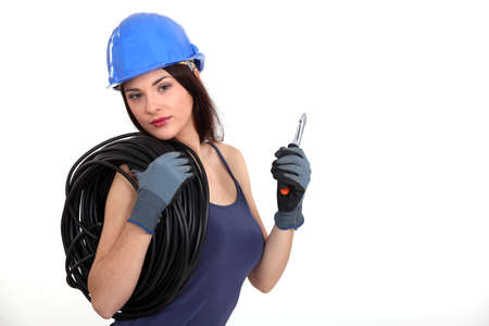 sexual activity: female electrician with coil of wire