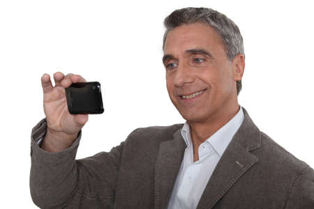 Man taking a self-portrait with his cameraphone Stock Photo - 16669935