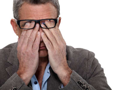 Man rubbing his eyes photo