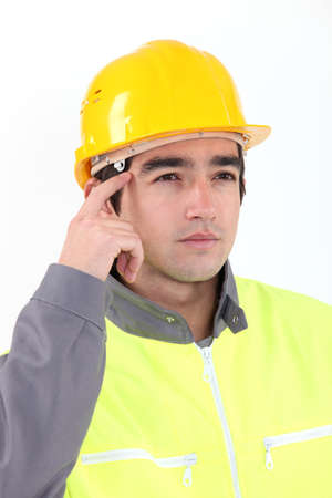 Pensive construction worker  Stock Photo - 16670187