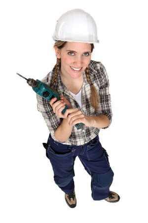high torque: Female builder with a drill