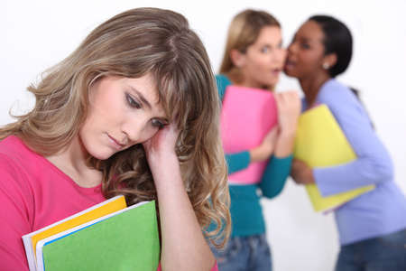 outcast: Girl being bullied at school Stock Photo