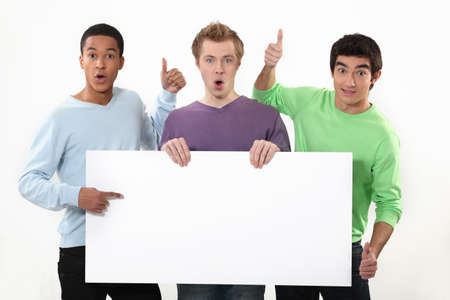 Three young white sign showing Stock Photo - 16670108