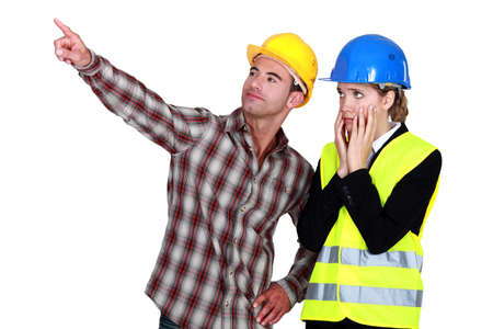 female architect looking appalled and male builder photo