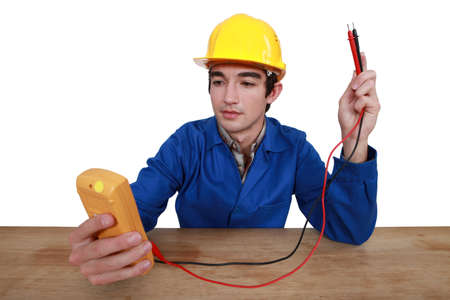 Tradesman using a multimeter Stock Photo - 16670392