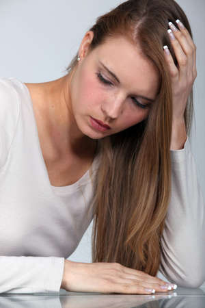 Blond woman with a headache Stock Photo - 16669449