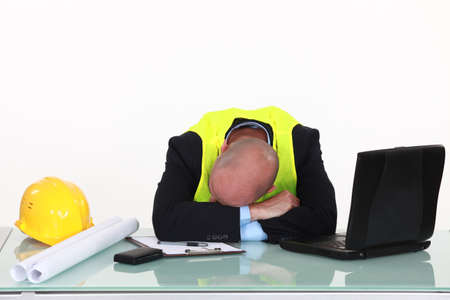 swamped: tired architect sleeping in office Stock Photo