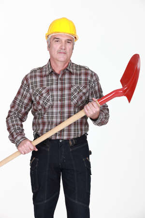mature bricklayer with shovel photo