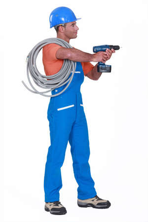 power operated: Electrician with a drill