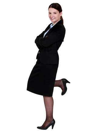 Businesswoman posing in a skirt suit photo