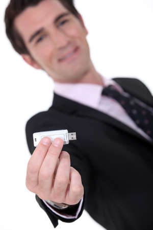 Businessman holding a memory stick photo