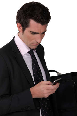 bewildered: Bewildered businessman reading a text message