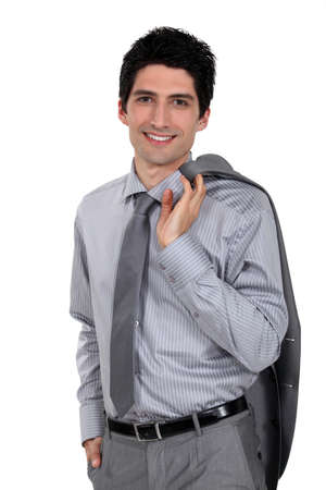 Man holding his suit jacket over his shoulder Stock Photo - 16669828