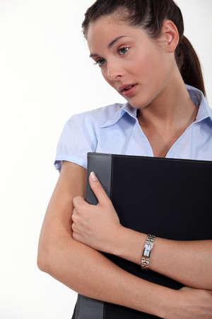 Worried brunette holding folder Stock Photo - 16670072
