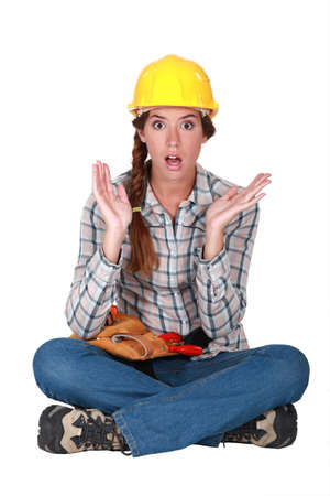 hand over: A clueless female construction worker  Stock Photo