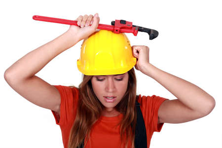 sexy construction worker: A female construction worker with a wrench