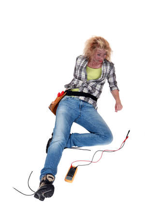 electric wires: craftswoman lying down after an electric shock