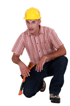 kneeling man: Construction worker kneeling