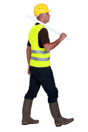safety boots: Tradesman walking on a building site