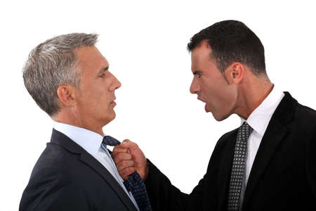controversy: businessmen fighting Stock Photo