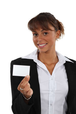Brunette brandishing business card Stock Photo - 16670451