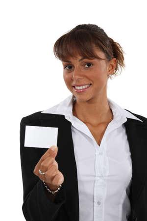 brandishing: Brunette brandishing business card