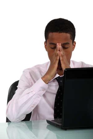 A black businessman having a headache