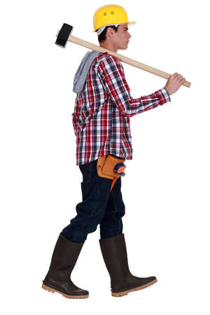 coverall: Man carrying sledge-hammer