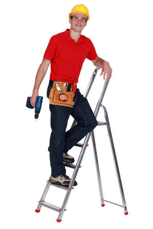 Repairman on a ladder Stock Photo - 16670998