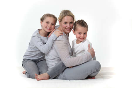 Woman hugging her children Stock Photo - 16670229