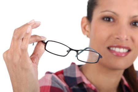 bifocals: Brunette holding glasses
