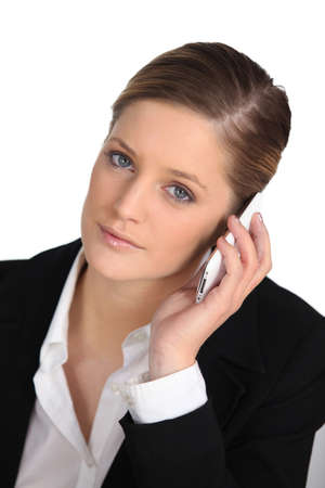 Young businesswoman listening to her cellphone photo