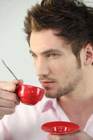 parentheses: Man with red coffee cup Stock Photo