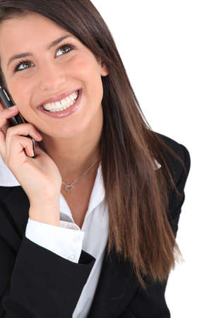 Brunette woman with phone Stock Photo - 16670254